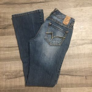 Vanity low rise flare leg jeans. Size 25X33